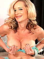 White haired MILF solo photo shoots