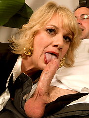 Mature secretary blows boss cock