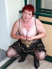 Naughty housewife masturbates on her balcony