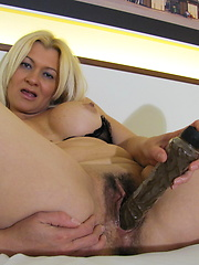 Appetite blonde milf grabs her pussy by dildo