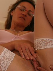 Mature in glasses appart her legs and shows pussy
