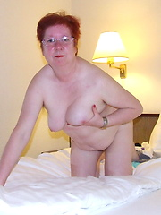 Redhead granny showing her hairy aged pussy