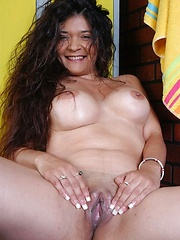 Pretty latina mature showing shaved pussy