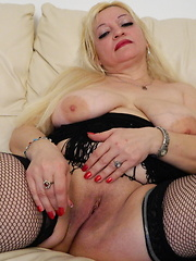 Busty blonde mature using sex toy