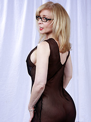 Nina Hartley gives nothing away in this SFW black dress set