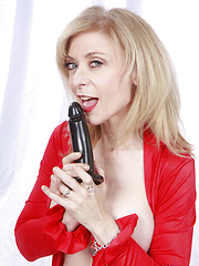 Nina Hartley red and white with sex toys