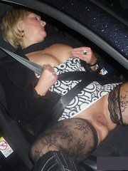 Funny car driving with semi-naked mature women