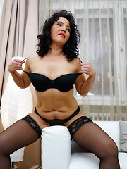 Naughty housewife loves to masturbate on her couch